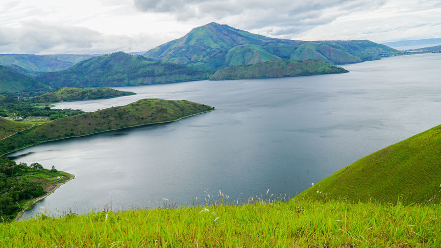 The view of hilly area near the famous Lake Toba, Indonesia Asia Landscape Asia Muslim Trave Danau Toba Danau Toba Grassy Hill Green Color Green Landscape Green Nature Hilly Berastagi Hilly Lake To Hilly M Hilly Samosir Lake Toba From Above Lake Toba Indonesia Lake Toba Landscape Lake Toba Mountai Medan Indonesia Medan Indonesia Lake Toba Landscape Mountain Near Lake Toba Outdoors Pantone Pantone Lansc Pentone Landsc View From Island To Lake Toba View From Samosir To Lake Toba