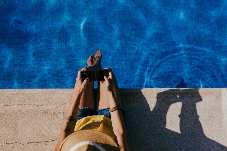 Full length of woman relaxing in swimming pool
