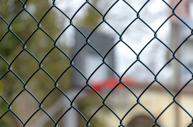 Fence Chainlink Fence Security Boundary Barrier Protection Safety Focus On Foreground No People Metal Full Frame Backgrounds Day Pattern Sport Close-up Nature Outdoors Crisscross Playing Field