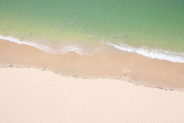 Beach Land Water Sand Sea Wave Motion Nature Surfing Sport Aquatic Sport Beauty In Nature Green Color Sunlight Outdoors Day White Color Power In Nature Drone Photography Summer Ocean View