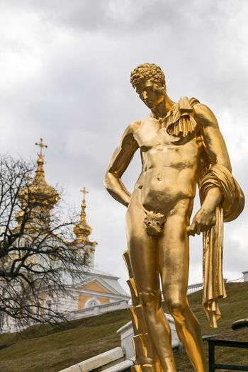 EyeAmNewHere Tourism In Russia Palace UNESCO World Heritage Site Russian Versailles Human Representation Art And Craft Sculpture Representation Statue Male Likeness Sky Architecture Low Angle View Cloud - Sky