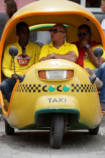 BYOPaper! Coco Taxi Cuba Cuba Collection Cuban Life EyeEm Gallery Fun Havana Land Vehicle Men Mode Of Transport People People And Places People Photography People Watching Real People Sitting The Portraitist - 2017 EyeEm Awards The Street Photographer - 2017 EyeEm Awards Togetherness Transportation Yellow Yellow Color