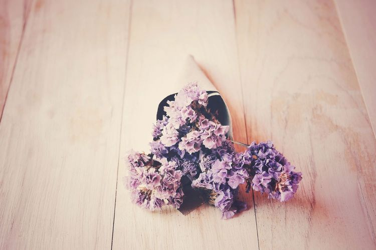 High angle view of purple flowering plant on table