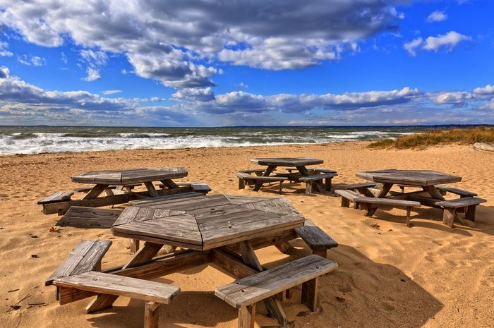 picnic tables on a cold windy day at the beach Picnic Table Beachphotography Cold Wind Connecticut Hammonasset Beach New England  Water Sea Beach Sand Table Sky Cloud - Sky Landscape