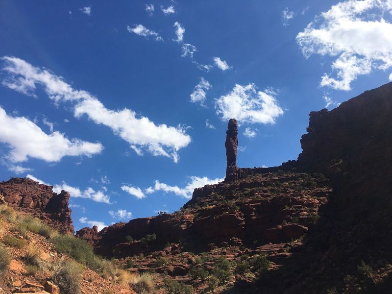 Lost In The Landscape Rock tower along Onion Creek near Moab, Utah Sky Tranquility Day Nature Sunlight Outdoors Beauty In Nature No People Low Angle View Cloud - Sky Landscape Travel Destinations Mountain Scenics Wilderness