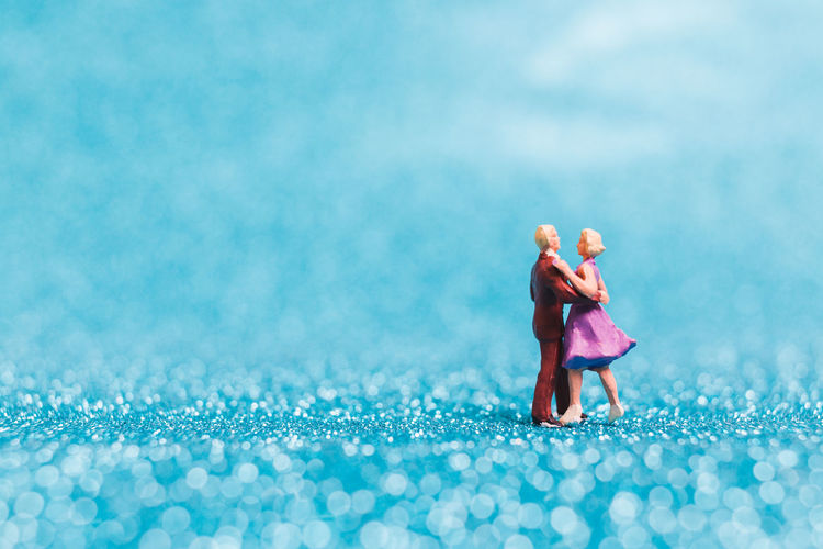 Miniature people , Couple dancing on blue glitter background Couple Dance Dancing Family Figure Glitter Happy Holiday Lady Life Love Man Activity Background Blue Club Day Happieness Leisure Activity Lifestyles Macro Miniature Party People Reaction