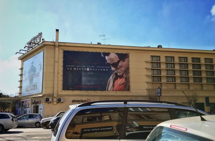 Pasolini Walking Street Photography Streetphotography Street Cinema Moving Around Rome Architecture Built Structure Building Exterior Land Vehicle Day Transportation Mode Of Transport Outdoors Car Sky City No People