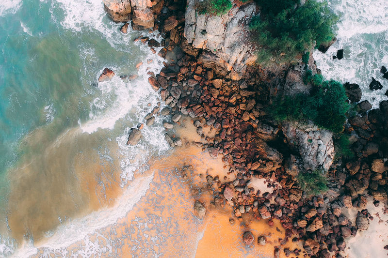 Water Solid Rock Sea Rock - Object Beauty In Nature No People Nature Day High Angle View Land Motion Outdoors Aerial View Scenics - Nature Beach Tranquility Pattern Non-urban Scene Power In Nature