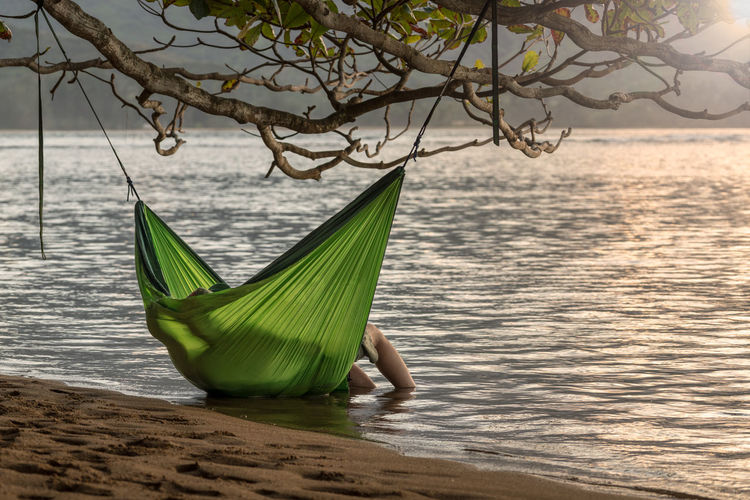 Person in hammock at beach