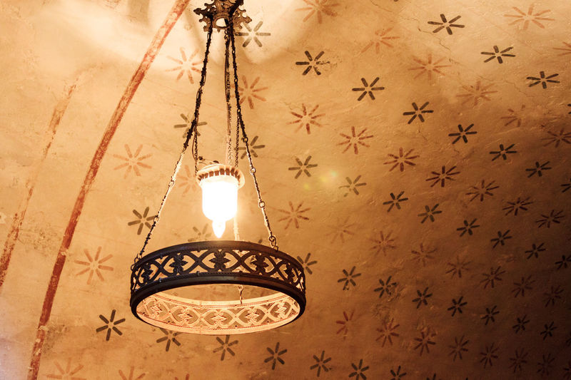 Antique Ceiling Design Electric Lamp Glowing Hanging Illuminated Indoors  Light Bulb Lighting Equipment No People Ornate Pattern Star Star Shape Wall - Building Feature