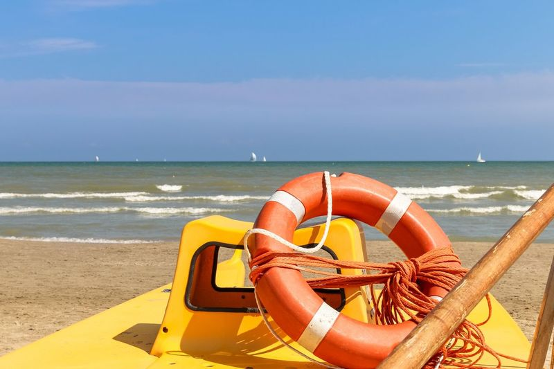 Lifebuoy on a lifeboat by the sea, Italy, Riccione Italy. Riccione Rimini Riccione Emiliaromagna Italy Rescue Boat Sea Lifeboat Orange Color Lifebuoy Horizon Over Water Beach Water Nature No People Sky Yellow Wave Outdoors Life Belt Sand Day Nautical Vessel Scenics