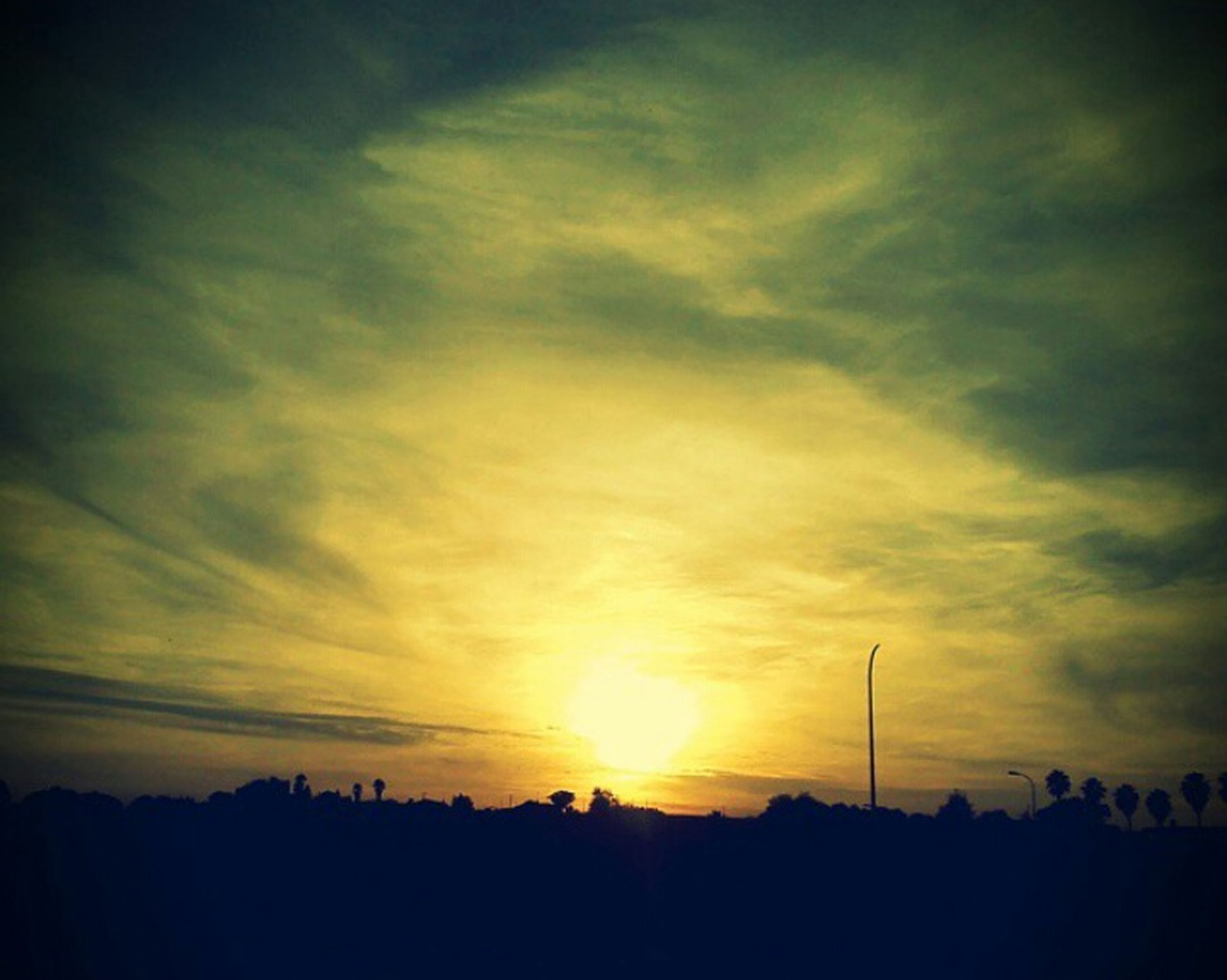 sunset, silhouette, sky, beauty in nature, scenics, cloud - sky, tranquil scene, tranquility, sun, orange color, nature, cloud, idyllic, landscape, sunlight, cloudy, dramatic sky, outdoors, outline, no people