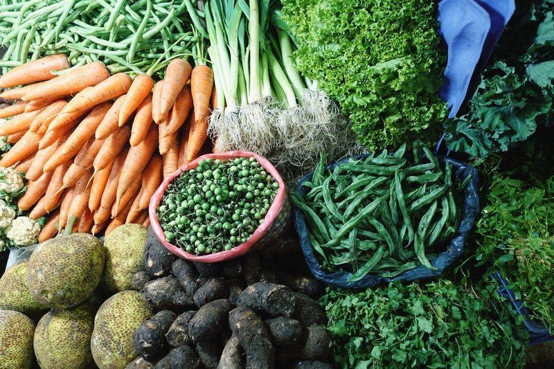 Fresh vegetables at the market. carrots, peas, leek, salad, okra, lady fingers, beetroot, yak fruits