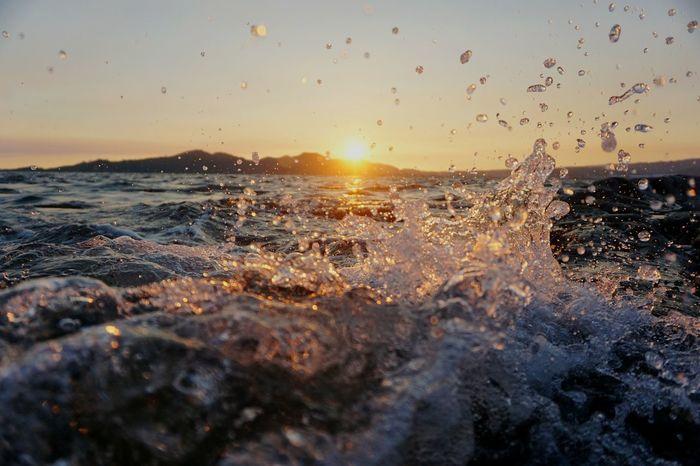 Sunset Sea Sun Splashing Motion Nature Beauty In Nature Water Beach Sunlight