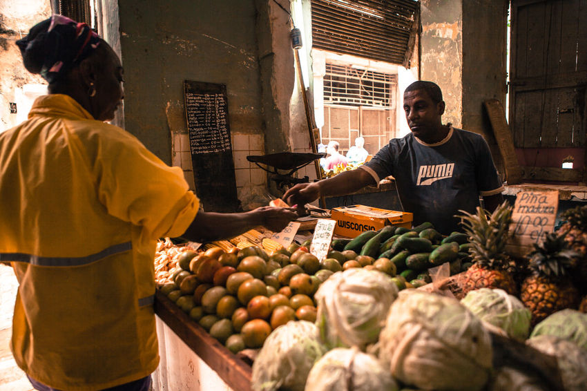 A grocer sells his fruit and vegetables on a stall at a local store. Agriculture Cuba Cuban Daily Life Dailyphoto Food Fruit Greengrocer Grocery Shopping Havana Local Food Market Market Stall Marketplace Old City Selling Shopping Small Business Store Streetphotography Trade Travel Vegetables Work