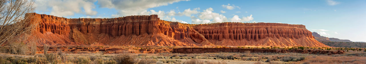 Panoramic Landscape in Torrey, Utah. This sandstone geological formation can be seen just outside the Capitol Reef National Park in the town of Torrey, Utah. Nature Ranch Torrey, Utah Utah Beauty In Nature Cattle Cloud - Sky Cows Day Environment Eroded Geological Geology Land Landscape Mountain Nature No People Outdoors Panoramic Rock Rock Formation Scenics - Nature Sky Travel Destinations