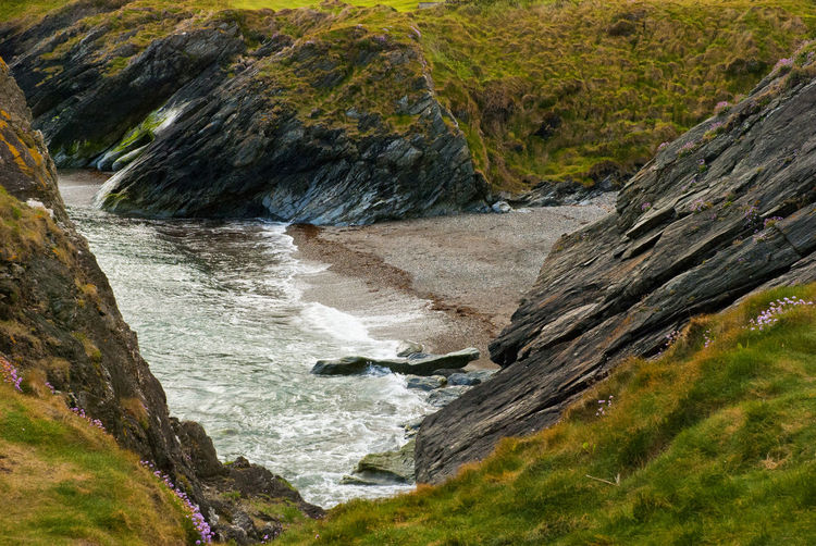 Scenic view of rocky shore by sea