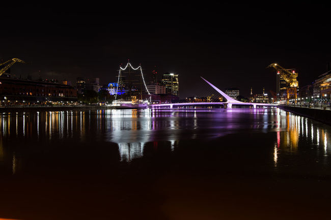 Buenos Aires Architecture Argentina Bridge - Man Made Structure Building Exterior Built Structure City City Life Cityscape Illuminated Night No People Outdoors Puente De La Mujer Reflection River Sky Transportation Travel Destinations Water Waterfront