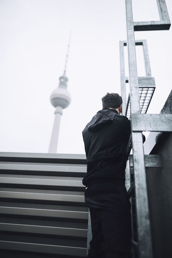 Architecture Building Exterior Rear View Tower Real People Built Structure Men Building Technology City One Person Communication Day Taking Photos Check This Out Berlin Cityscape City Life City Exploring Explore Ladder Urban Skyline Urban EyeEm