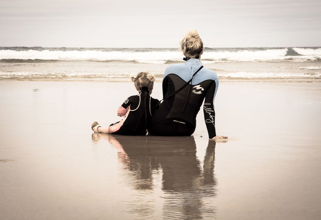 Sharing the same passion Adult Back Beach Cornwall Day Family Horizon Over Water Looking At The Sea Love Mother & Daughter Nature Ocean Outdoors People Sea Surfers Tide Water Water Reflections Watergate Bay Wet Wetsuit Women Around The World