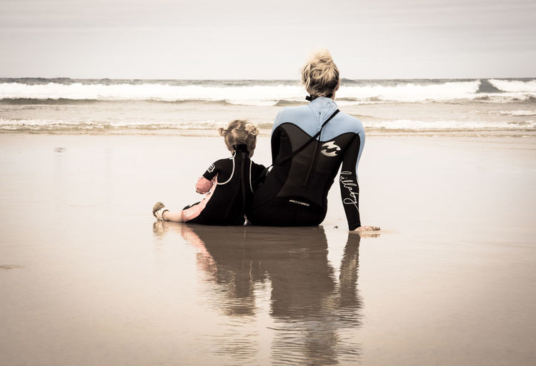 Sharing the same passion Adult Back Beach Cornwall Day Family Horizon Over Water Looking At The Sea Love Mother & Daughter Nature Ocean Outdoors People Sea Surfers Tide Water Water Reflections Watergate Bay Wet Wetsuit Women Around The World This Is Family