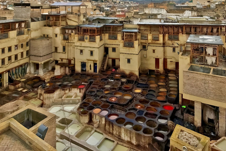 The leather tannery and dyeing operation at Fès in Morocco. Architecture Balcony Building Terrace Buildings Built Structure Day Dyeing Fes High Angle View Leather Morocco Pots Tannery Travel Destinations
