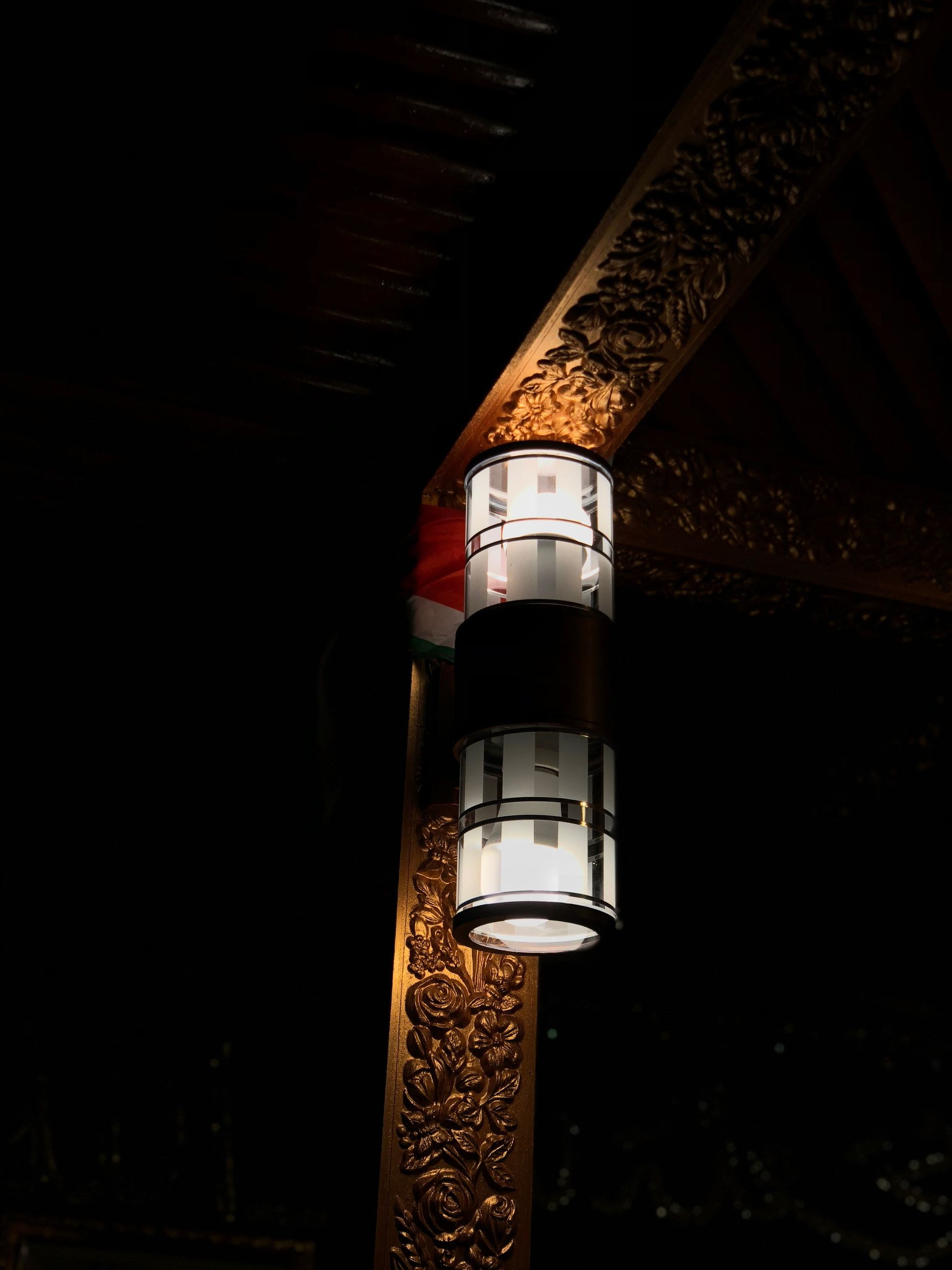 no people, built structure, architecture, illuminated, low angle view, building exterior, night, building, tower, lighting equipment, metal, sky, nature, outdoors, guidance, tall - high, close-up, light - natural phenomenon, factory