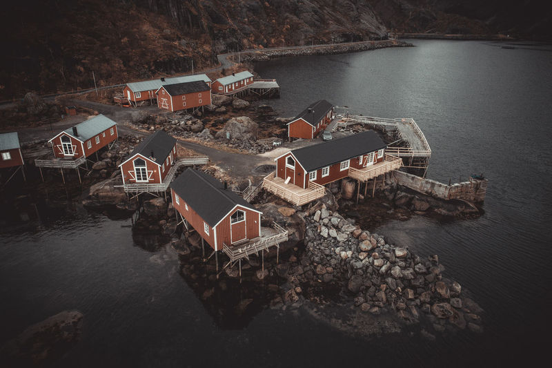 High angle view of houses by sea and buildings