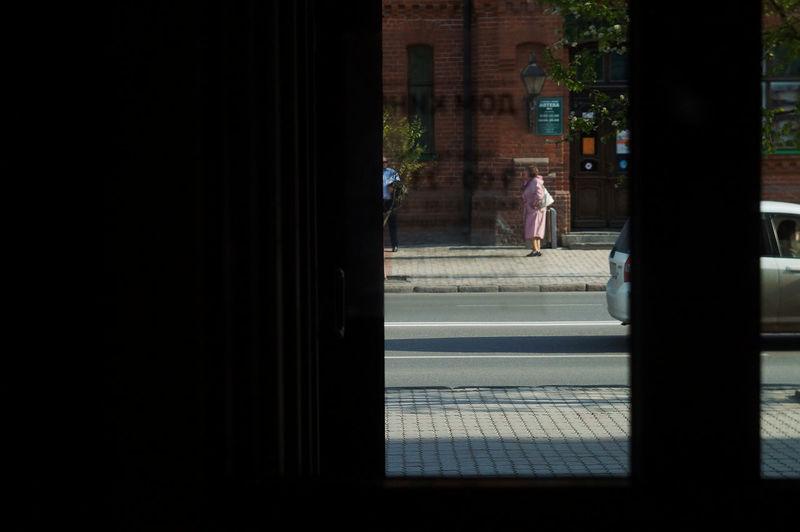 Man walking on window