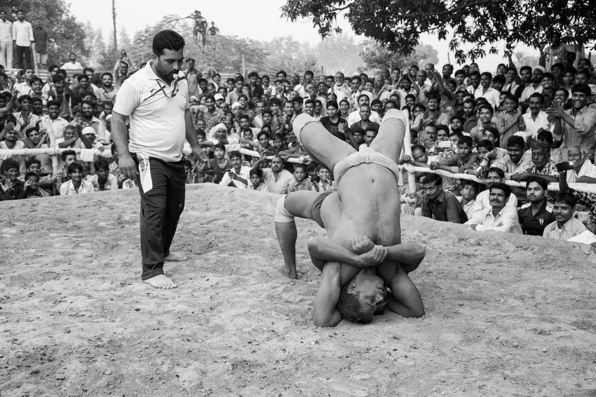 Dangal, also known as Kushti, is an Indian form of wrestling played in mud. It is still popular form of entertainment and spoort in smaller towns and villages in India. Pictured here is a local competition held in a popular fair in Deva, Barabanki, India. Dangal India Indian Wrestling Kushti Sports Street Photography Streetphotography The Street Photographer - 2017 EyeEm Awards Wrestling Mix Yourself A Good Time Done That. Been There. Be. Ready. Summer Sports