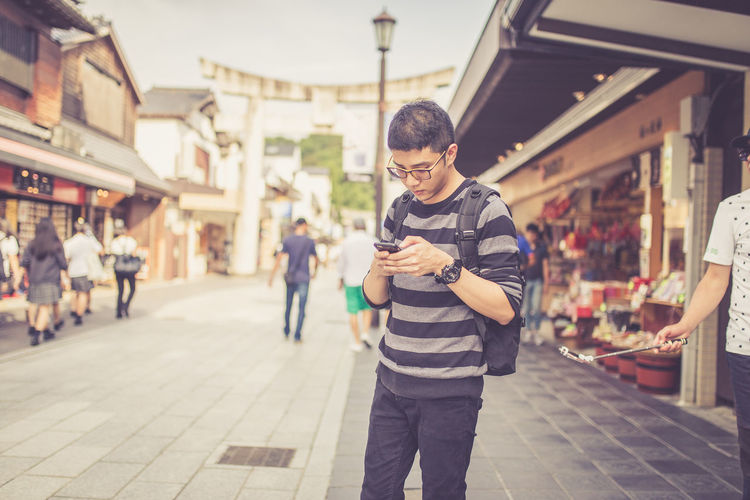 Man using mobile phone while standing in market