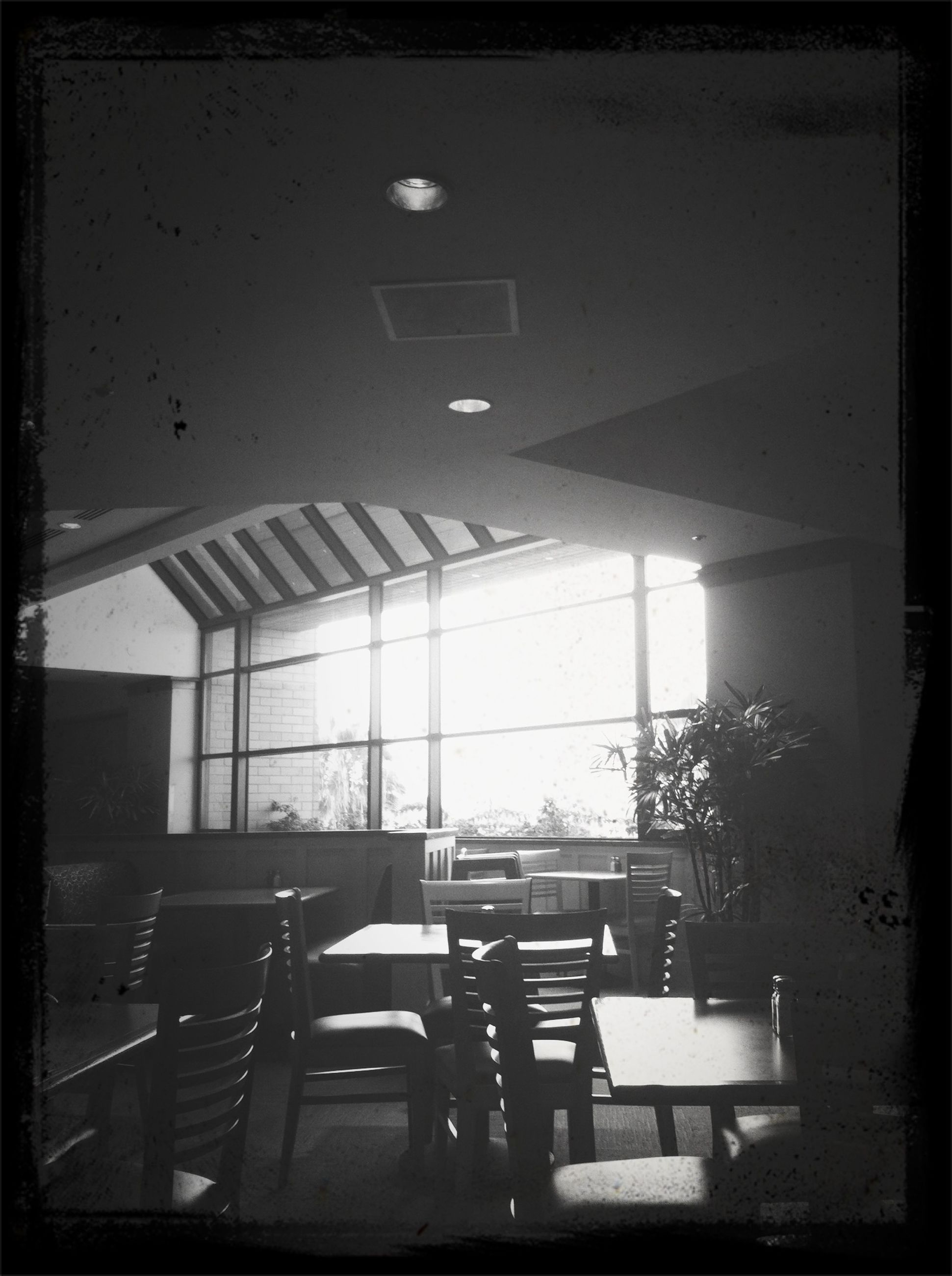 indoors, transfer print, chair, architecture, auto post production filter, built structure, absence, empty, window, table, illuminated, restaurant, building exterior, lighting equipment, no people, city, day, home interior, house, interior