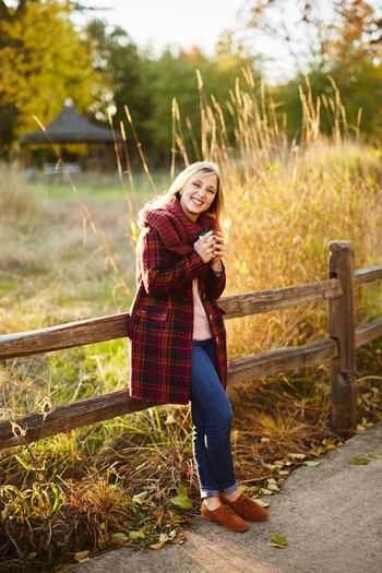 Adult Adults Only Beautiful Woman Beauty Casual Clothing Day Full Length Grass Happiness Long Hair Looking At Camera Nature One Person One Woman Only One Young Woman Only Only Women Outdoors Portrait Real People Smiling Standing Tree Women Young Adult Young Women