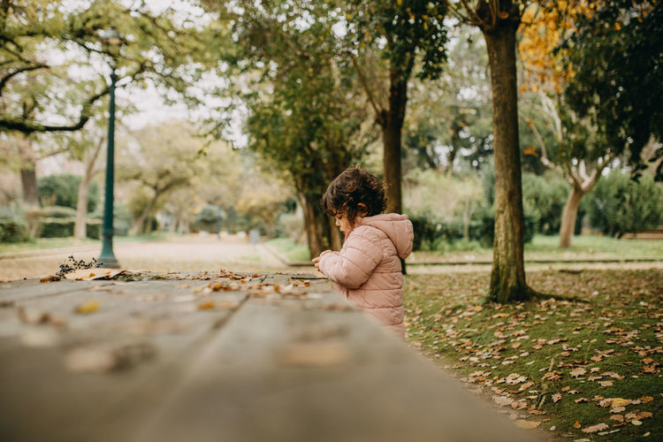 Rear view of woman sitting in park
