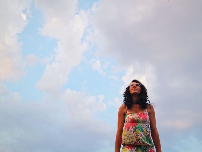 Low Angle View Of Girl Against Sky