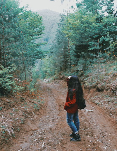 attention, attention, girl in red, jeans and dr.martwns is on the perimeter Yellow Canonphotography EyeEm Nature Lover EyeEmNewHere Mobilephotography Fresh Vscocam Photography Themes Girl Photooftheday Beauty In Nature EyeEm Best Shots Closeup Blooming Outdoors Green RainyDay Tree Full Length Standing Women Hiker Hiking Pole Rocky Mountains Mountain Climbing Woods Hiking Stream Growing Foggy Backpack Stay Out