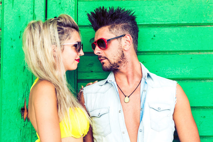 Young Adult Fashion Sunglasses Glasses Togetherness Couple - Relationship Adult Young Men Real People Two People Men Emotion Young Women Heterosexual Couple Bonding Women People Lifestyles Portrait Hair Positive Emotion Hairstyle Outdoors Arm Around Mustache