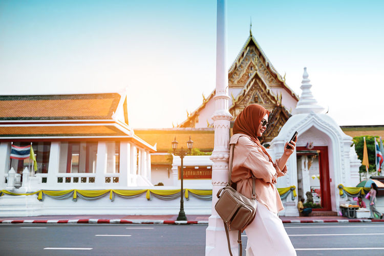 Low angle view of woman against temple building