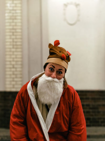 Celebration Christmas December Funny Holiday Santa Santa Claus Xmas Adult Beard Costume Facial Hair Female Model Focus On Foreground Front View Hat Joy Looking At Camera One Person Portrait Real People Red Young Adult