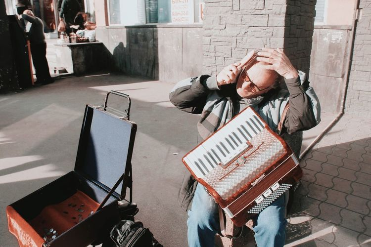 Gotta comb that hair first Musical Instrument Music Streetphotography One Person Real People High Angle View Architecture Lifestyles Day Communication Sunlight Sidewalk Street Social Issues City