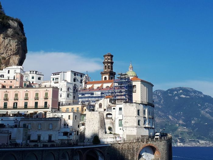 Amalfi's coast.  buildings in city against blue sky