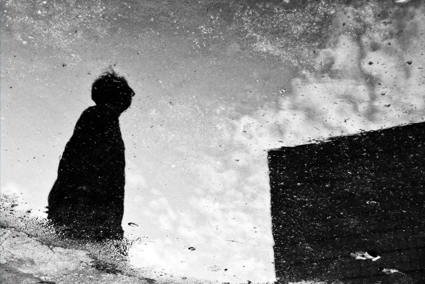 《The Reflection of a society》 After a rainy day, I walked through the street, and I noticed that it just seems like a society reflected on a water of the ground. Black And White Black And White Photography Blackandwhite Ground Human Body Part Reflection Reflection_collection Reflections In The Water Showcase: February Streetphoto_bw Streetphotography Xhinmania The Street Photographer - 2016 EyeEm Awards