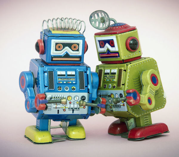 two little bots gossiping Did You Know? Fun Gossip Retro Robots Chating With Friend Childhood Close-up Conceptual Creativity Figurine  Friendship Fun Gossiping Multi Colored Play Rumors Secret Sharing A Moment Small Still Life Studio Shot Talking Togetherness Toy