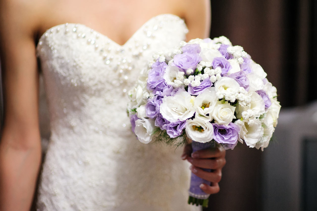 Close-Up Of Woman Holding Bridal Bouquet