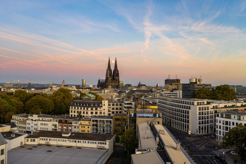 Cologne cathedral at sunset, moon showing up between the towers Architecture City Sunset Cloud - Sky Outdoors Drone Photography High Angle View Cityscape Sky Clouds And Sky