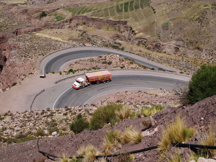 High angle view of vehicles on road along landscape