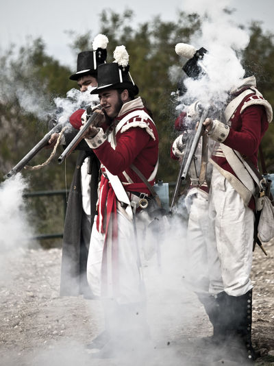 Musketeers Soldier Uniform Adult Army Soldier Day Fire Mammal Men Military Military Uniform Musket Musketeer Musketeers Muskets Outdoors People Real People Togetherness Uniform War Weapon