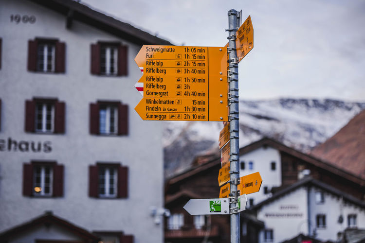 Street sign in Switzerland. Sign Communication Text Information No People Guidance Information Sign Western Script Road Sign Day Outdoors
