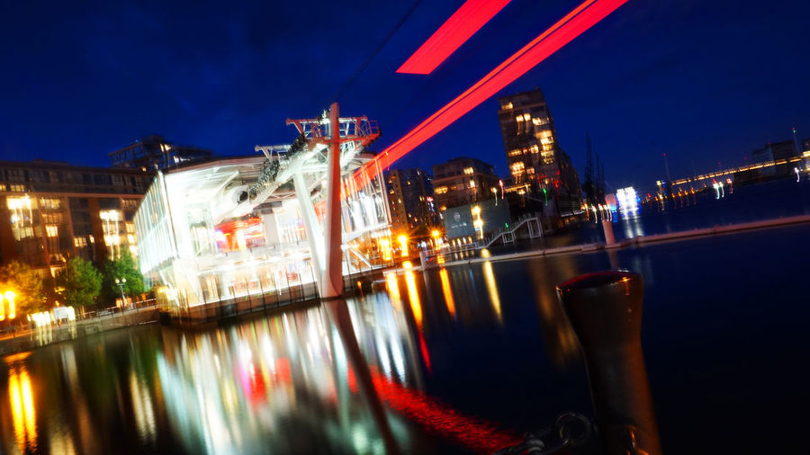 Emirates Air Line London Air Line Architecture Blurred Motion Building Exterior Built Structure Cablecar City Illuminated Innercity Cablecar Long Exposure Mode Of Transportation Motion Nature Nautical Vessel Night Nightlife No People Outdoors Reflection Sky Speed Transportation Water