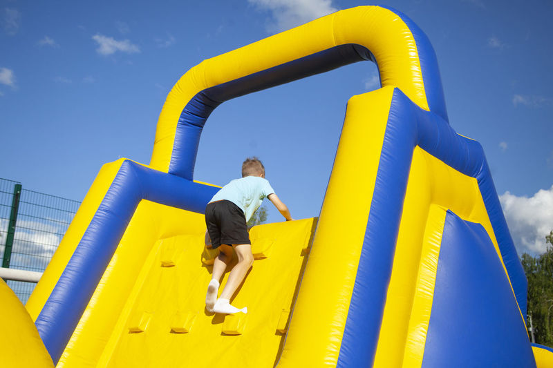 Low angle view of full length of man standing at playground